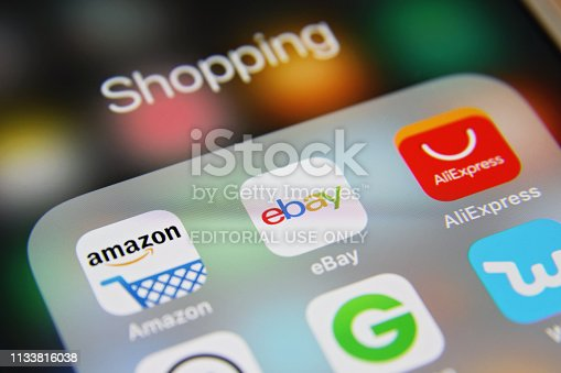 London, UK - 03 04 2019: Apple iPhone 6s screen with Online shopping e-commerce mobile app icons applications Amazon, Ebay, AliExpress, Groupon, Wish etc.