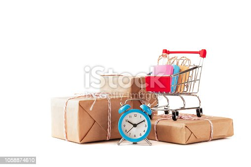 online  shopping / e-commerce sale and delivery service concept, discounts, black Friday, sale: shopping cart multicolored packages and boxes with trolleybus logo on white background,