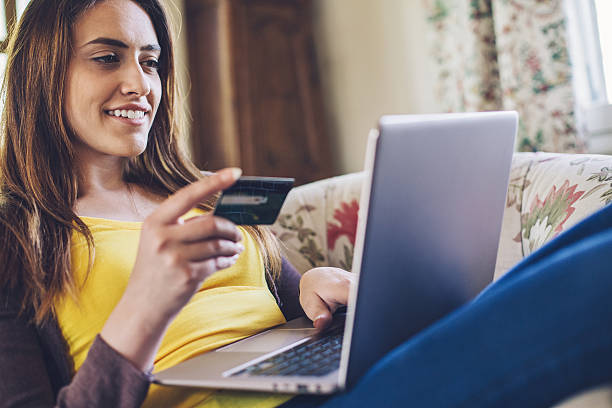 on-line shopping from home - spending money stock photos and pictures