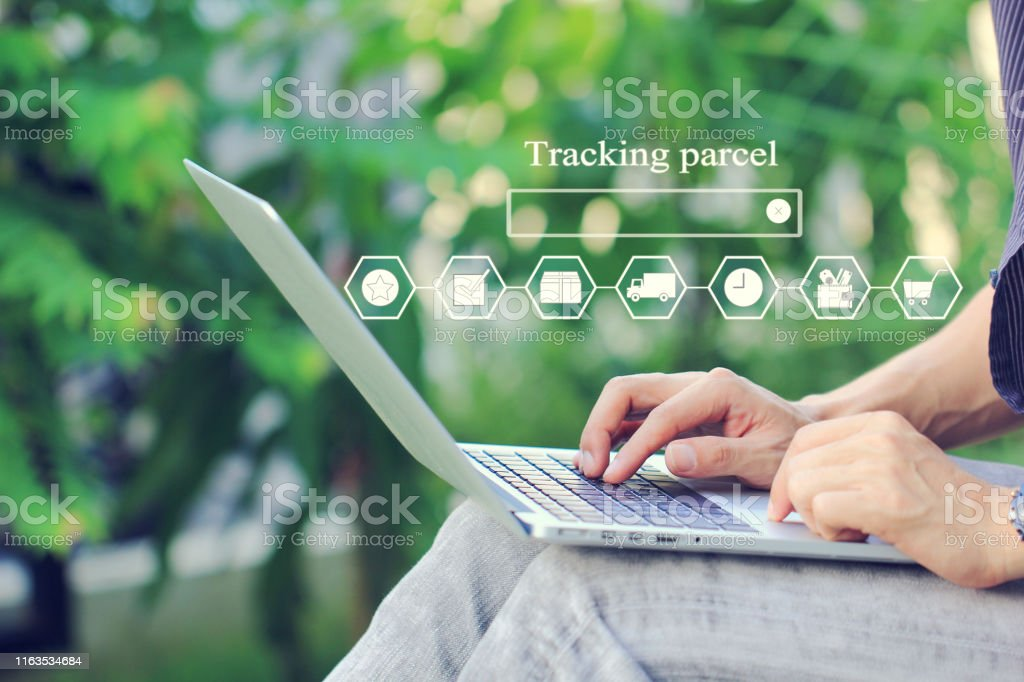 Online shopping, Woman using laptop computer and tracking parcel...
