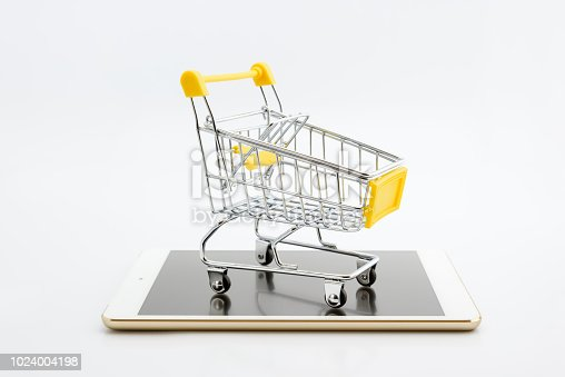 868776578istockphoto Online shopping or ecommmerce and international freight service concept : Paper boxes with logos in a shopping cart on a white smart mobile phone device. Consumers always shop goods using the internet 1024004198