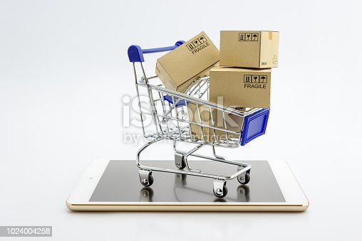 868776578 istock photo Online shopping or ecommmerce and international freight service concept : Paper boxes with logos in a shopping cart on a white smart mobile phone device. Consumers always shop goods using the internet 1024004258