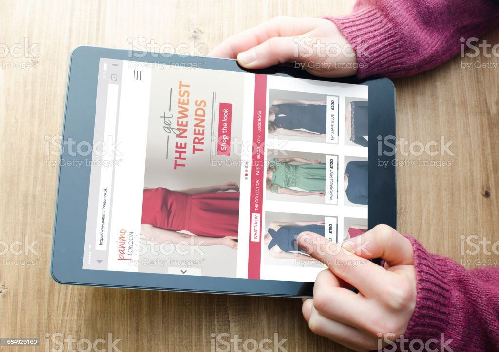 Online shopping with a digital tablet computer from home stock photo