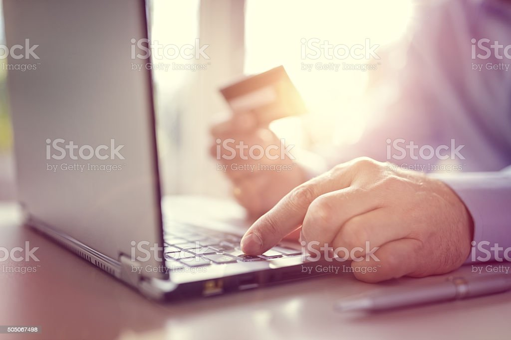Online shopping with credit card and laptop computer stock photo