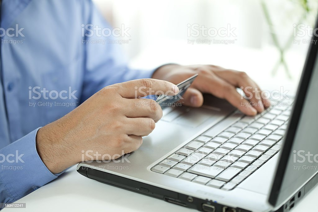 Online shopping with credit card on laptop royalty-free stock photo