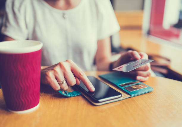 online shopping with credit card - spending money stock photos and pictures