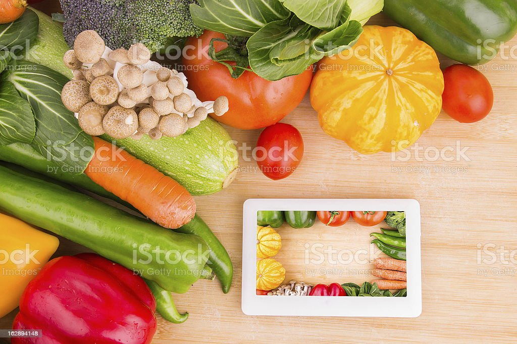 online shopping:Vegetables variety and tablet computer stock photo