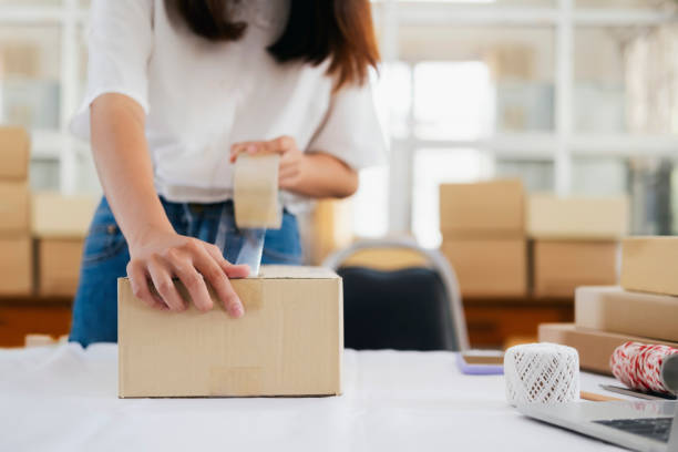 Online small business owner. Online small business owner. Young startup entrepreneur online small business owner working at home, packaging and delivery situation. sell online stock pictures, royalty-free photos & images
