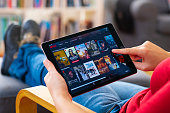 istock Online streaming with tablet pc 1208363215
