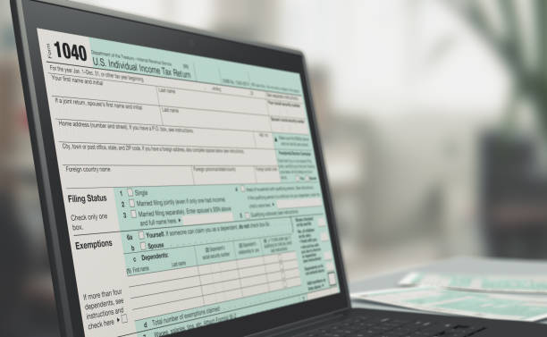 online tax filing closeup of a computer laptop with a tax form on screen, concept of online tax filing (3d render) 1040 tax form stock pictures, royalty-free photos & images