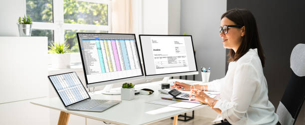 Online Taxes And Invoice Using Computer stock photo