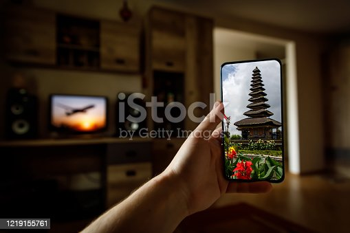 Online travel to Bali island via mobile phone from home