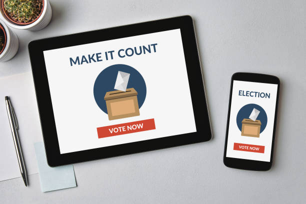 Online voting concept on tablet and smartphone screen stock photo