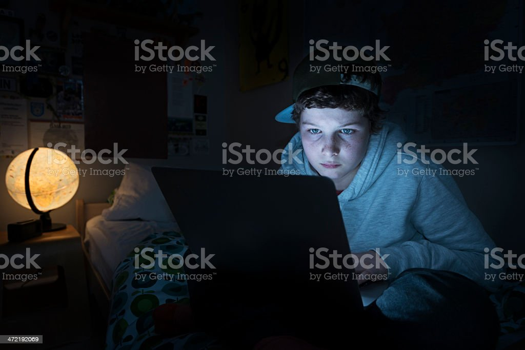Online Young Teen in His Bedroom stock photo