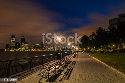 Quiet night over Manhattan waterfront, featuring New Jersey skyline on the background