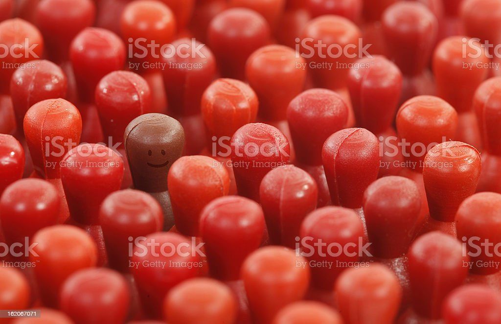 Only one piece is smiling between indifferent crowd royalty-free stock photo