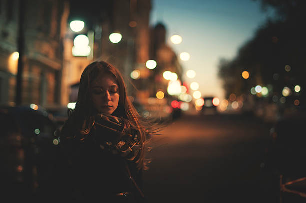only woman on the night street stock photo
