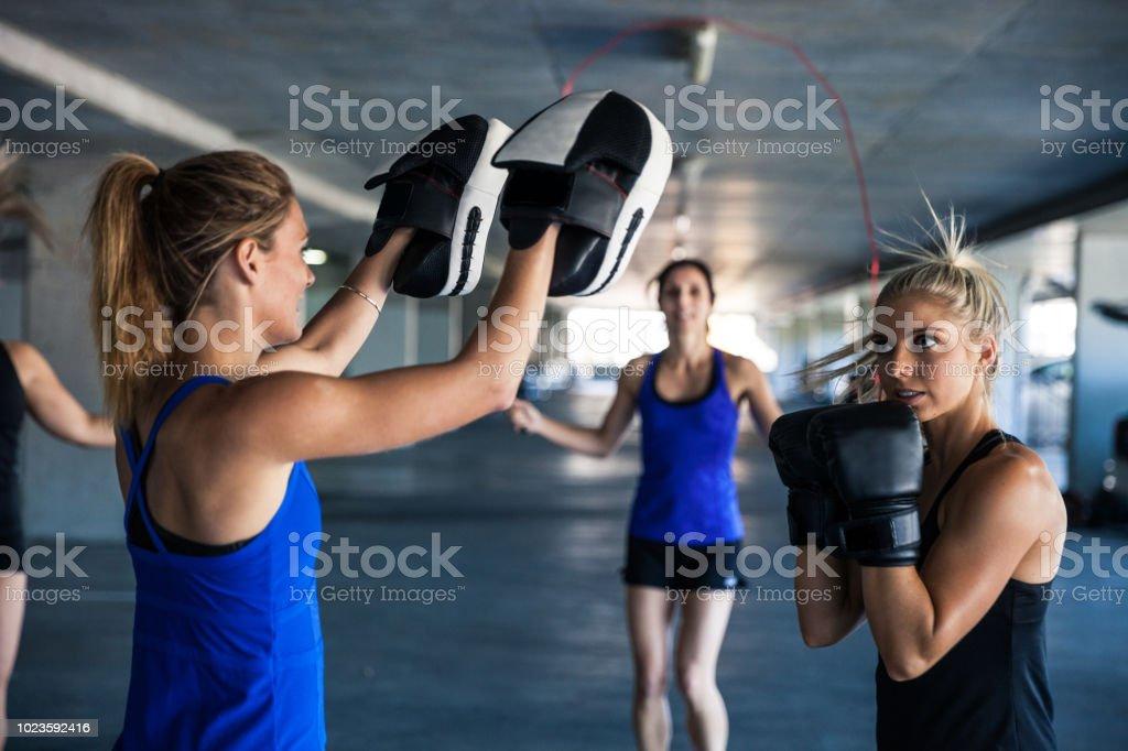 Only women sport team boxe training outdoor