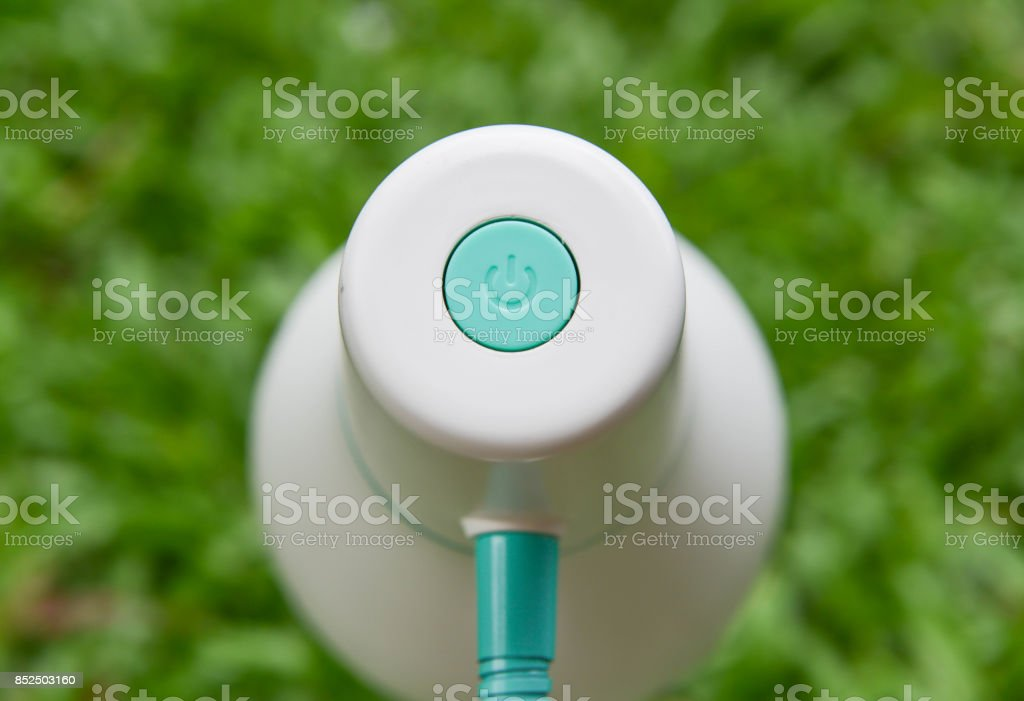 On-Off button of lamp with green grass background stock photo