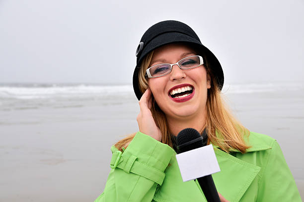 On-Scene Weather Reporter Laughs at Anchor's Comment stock photo