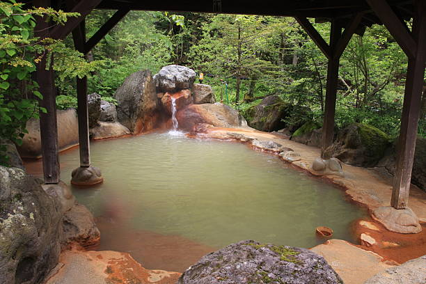 onsen - hot spring stock photos and pictures