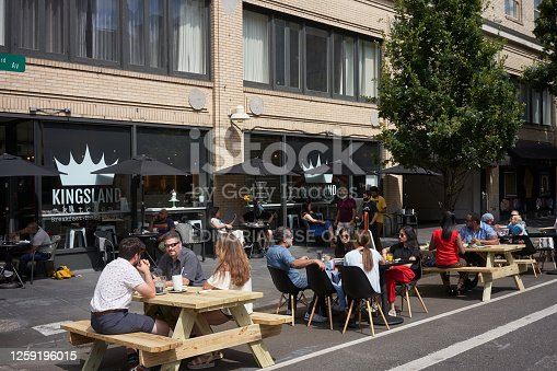 Portland, OR, USA - July 11, 2020: On-street outdoor dining on a Saturday morning at a breakfast, brunch, and lunch joint in downtown Portland, Oregon, amid the coronavirus pandemic.