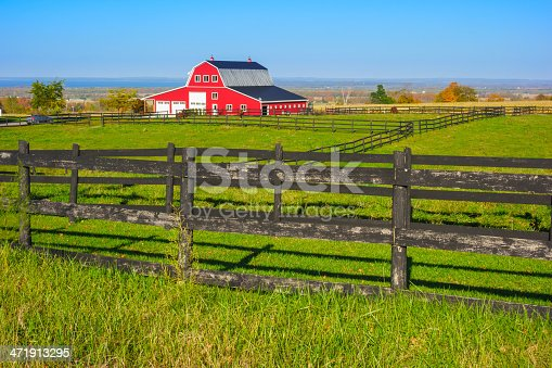 Beautiful landscape with red barn near Collingwood, Ontario with Georgian Bay in the background.