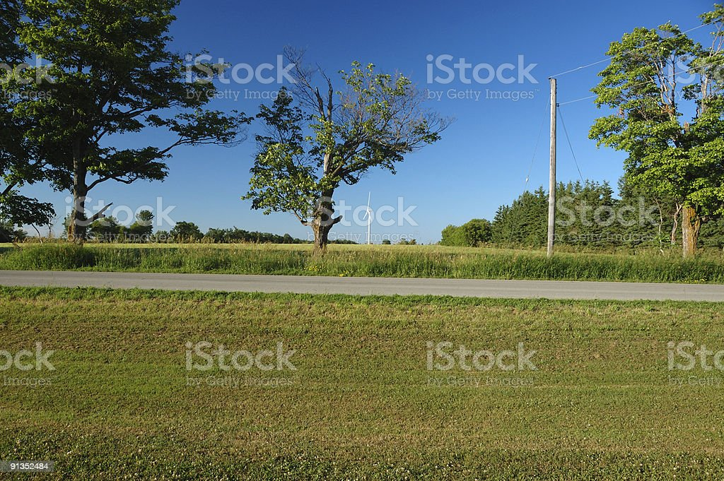 Ontario country road with a windmill in the background royalty-free stock photo