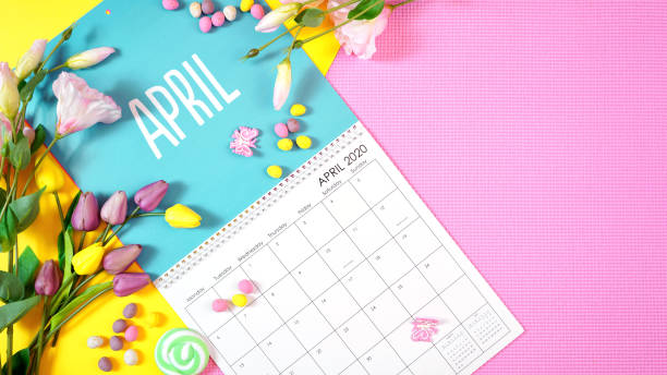 On-trend 2020 calendar page for the month of April modern flat lay On-trend 2020 calendar page for the month of April modern flat lay with seasonal food, candy and colorful decorations in popular pastel colors. Copy space. One of a series for 12 months of the year. April stock pictures, royalty-free photos & images