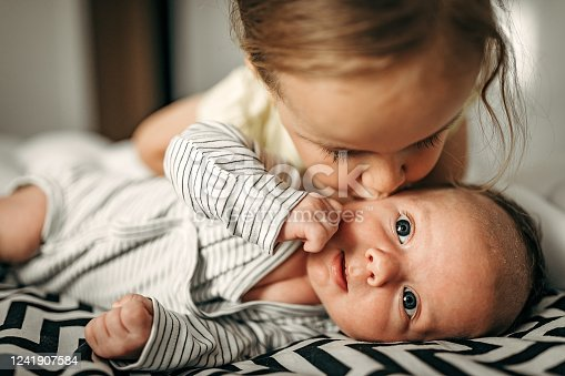 Girl playing with baby brother
