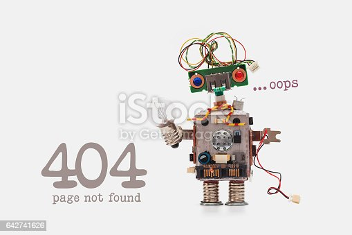 istock Oops 404 error page not found. Futuristic robot concept with electrical wire hairstyle. Circuits socket chip toy mechanism, funny head, colored eyes, light bulb in hand. beige background 642741626