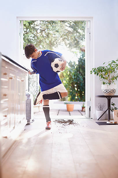 oops! better clean that up before mom sees - dirty shoes stock photos and pictures