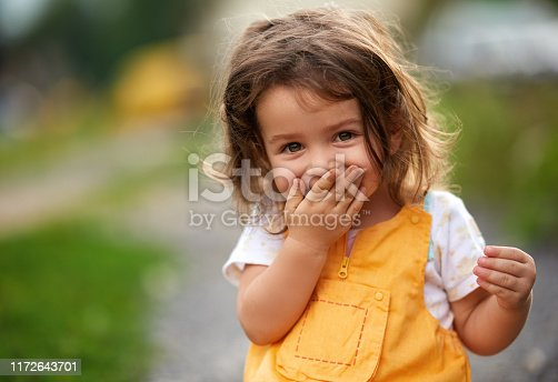 istock Oops! Little girl laughing 1172643701