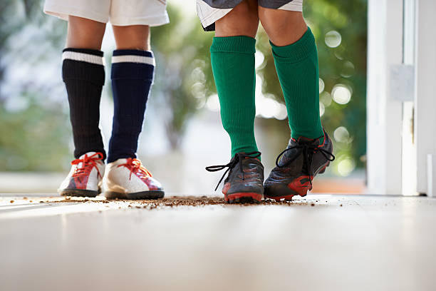 Oops! Mom's not going to be happy about that! Cropped shot of two boys in sports clothing standing in a doorwayhttp://195.154.178.81/DATA/shoots/ic_783804.jpg studded stock pictures, royalty-free photos & images