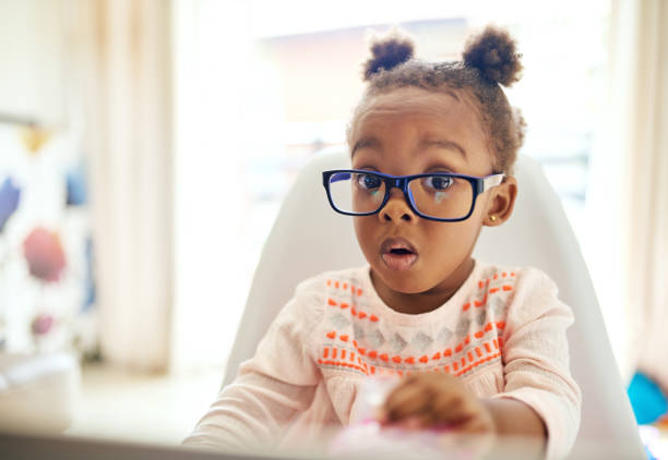 Oops... Cropped portrait of an adorable little girl looking shocked while sitting down at home disbelief stock pictures, royalty-free photos & images