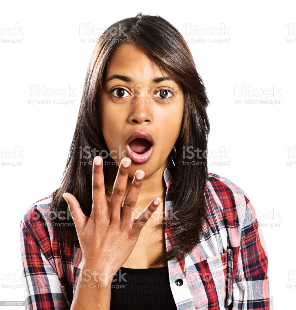 Oops! Pretty brunette wide-eyed and open-mouthed in shocked surprise royalty-free stock photo