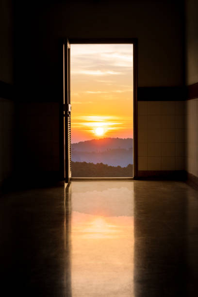 oor open from a dark building corridor to golden sunrise, Start a new life Concepts oor open from a dark building corridor to golden sunrise on the hill, Start a new life Concepts fresh start morning stock pictures, royalty-free photos & images