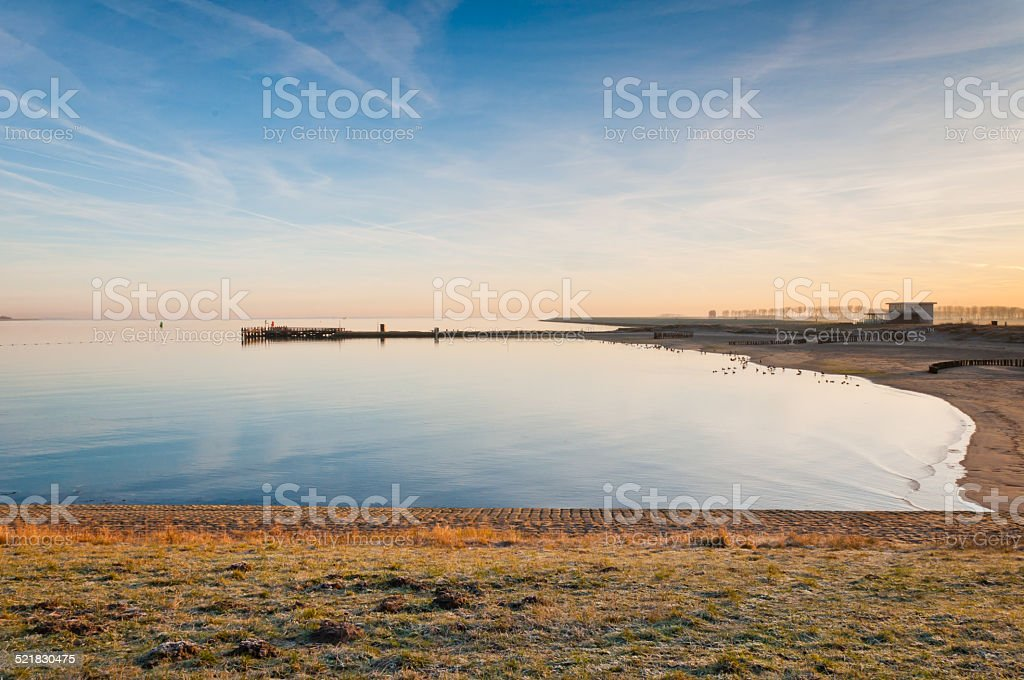 Oosterschelde lough in the low morning sun stock photo