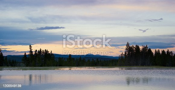 istock Opal Pool Surrounded by Forest at Dusk/Sunset in Yellowstone National Park in Wyoming 1205549139