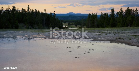 istock Opal Pool Surrounded by Forest at Dusk/Sunset in Yellowstone National Park in Wyoming 1205578209