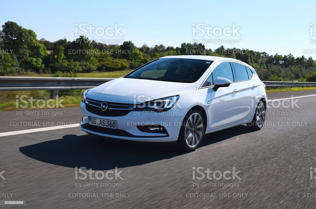 Opel Astra V driving on the highway stock photo