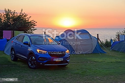 Leba, Poland - 27th July, 2018: Opel Grandland X on the camping during the daybreak. This model is the largest SUV in Opel offer.