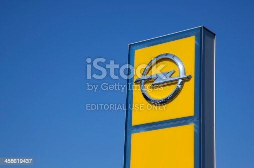 Antalya, Turkey - October 27th, 2011: The roadside yellow sign of Opel Company brand name and local dealership. German automobile company founded by Adam Opel in 1862. The company is headquartered in RAsselsheim, Germany. Opel Company management is under control by different companies: %35 in GM, %35 in Russian Sberbank, %20 in Magna International, %10 in German Goverment. Opel AG is one of the most traditional car manufacturers in Germany, and one of Europeaas largest automakers.
