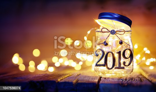 istock Open 2019 - Christmas Lights In The Jar - Blurred Background 1047536074