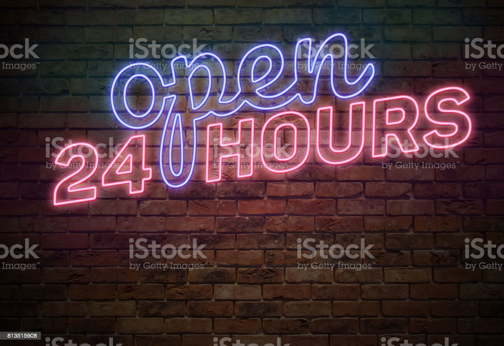 Open 24 Hours Sign on the Brick Wall stock photo