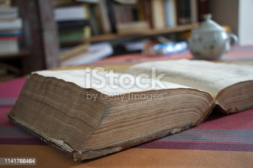 istock Open 400 year old antique book. Has that beautiful patina that only centuries can create. 1141766464