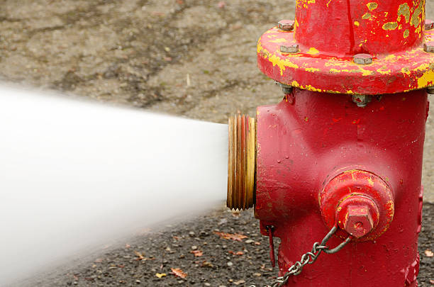 Open 5 inch  fire hydrant stock pictures, royalty-free photos & images