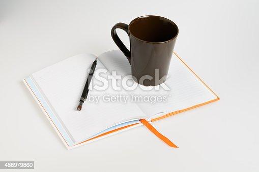 621843818istockphoto Open a blank white notebook 488979860