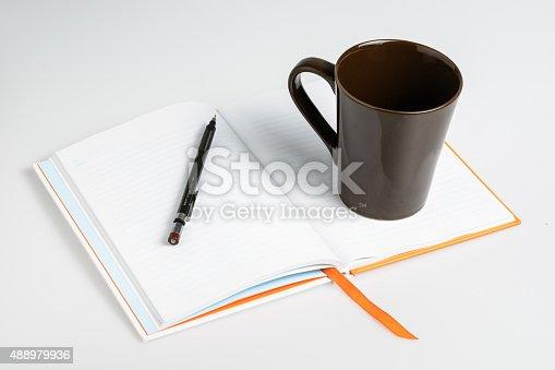 621843818istockphoto Open a blank white notebook 488979936