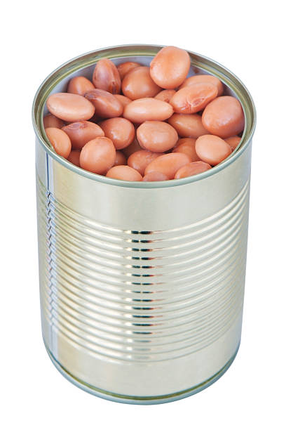 Open a can with tin beans. stock photo